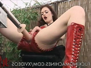 Redhead fucked by machines