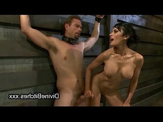 Busty brunette babe jerks off cock to bound slave